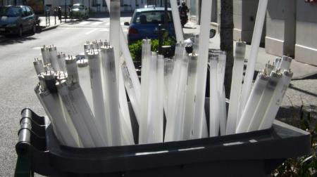 Neon tubes are placed in a trash can in Vincennes near Paris
