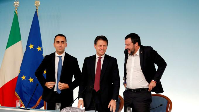 FILE PHOTO: Italy's Minister of Labor and Industry Luigi Di Maio, Prime Minister Giuseppe Conte and Interior Minister Matteo Salvini leave at the end of a news conference after a cabinet meeting at Chigi Palace in Rome